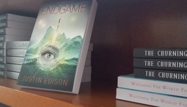 Justin Edison's three available books on a shelf