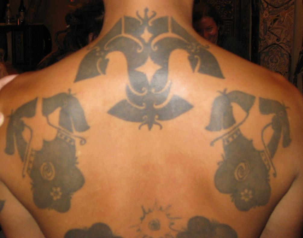 whole back design (including top design meant to protect the neck from being cut)