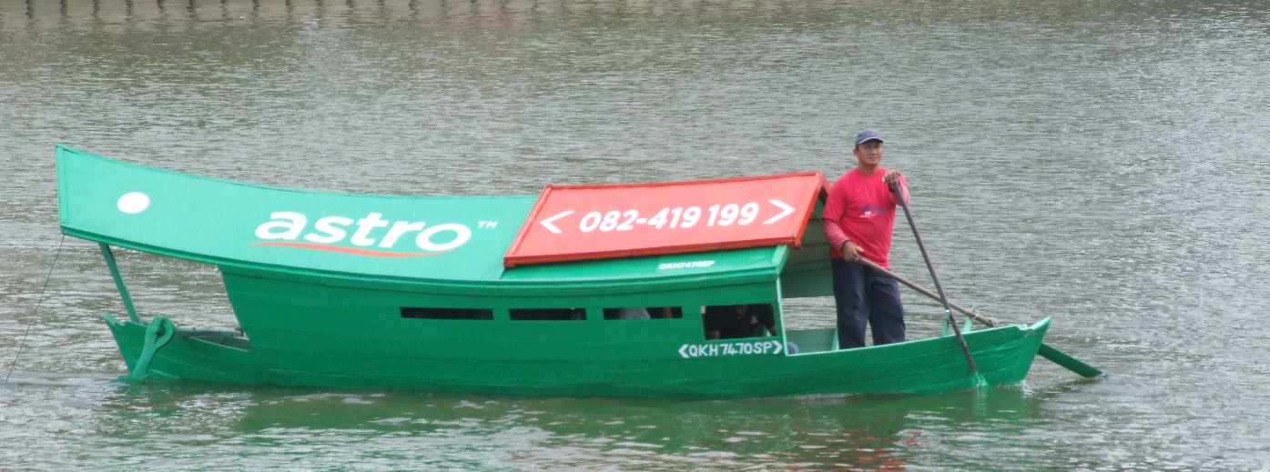 One of the Sampans or the water taxis you can use to get across the river.