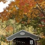 Fall foliage over Saco River covered Bridge