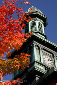 Town hall in Willimantic Connecticut old copper tarnished green with blue autumn sky