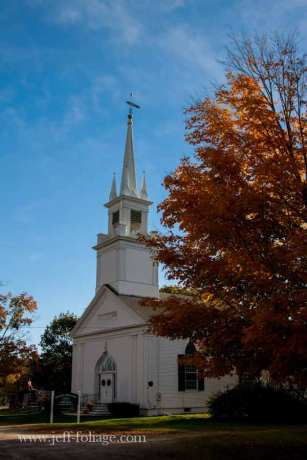 Under a canopy of Maine fall foliage is the Elijah Kellogg Church, Congregational