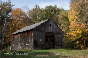 Massachusetts barn setback from the road with trees of yellow and green around