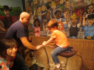 Nathan riding a bull