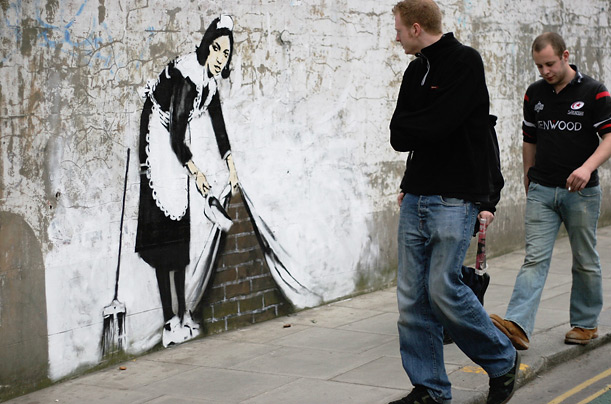 Sweeping things under the...?  Street image by Banksy