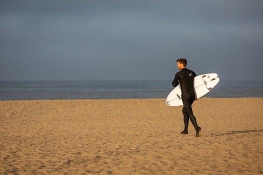 surfer on the sane in Huntington Beach, California