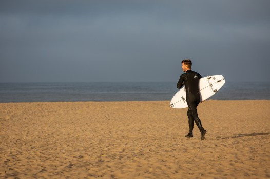 surfer on the sane in Huntington Beach, California