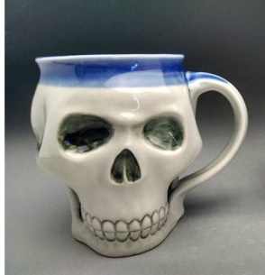 clear glaze on the outside, with Blue glaze inside, and over the outside of the rim.