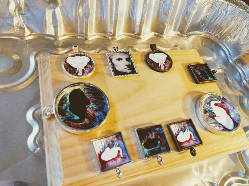 photo of resin necklaces featuring my elephant watercolor paintings, by Jeffcoat Art