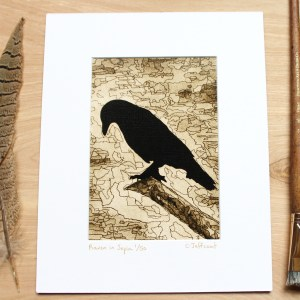 painting of raven on branch in sepia