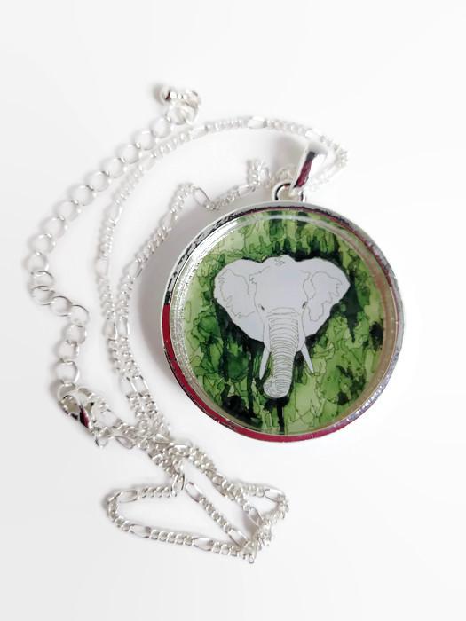 image of round elephant necklace with white photo background