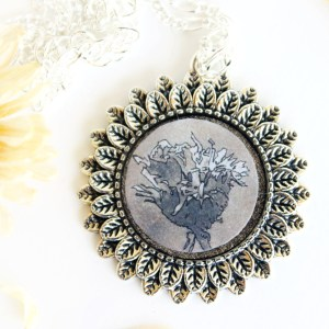 Summer Country No.10 Necklace-sepia flower drawing in silver circle setting with feathered rim. Handmade by Jeffcoat Art