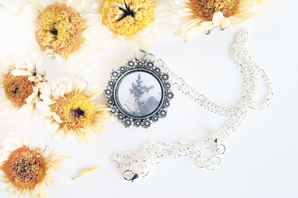 Summer Country No.5-Necklace-sepia flower in silver circle setting framed with flowers by Jeffcoat Art