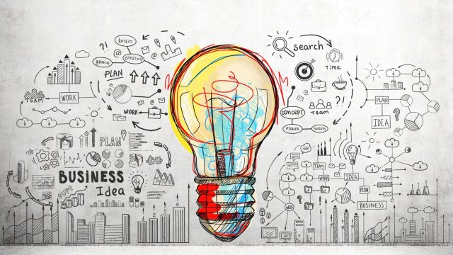 A colourful lightbulb surrounded by black and white images of business frameworks