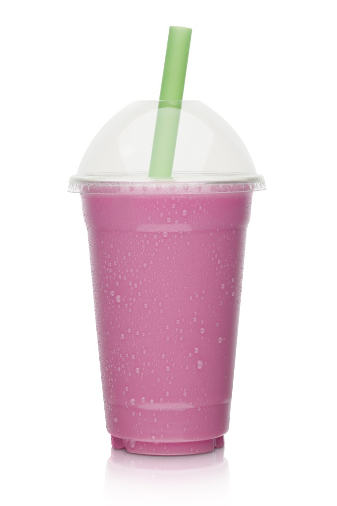big pink milkshake in a to go cup