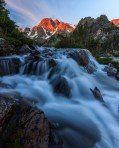 Early morning image of Pine Creek outlet falls and alpenglow on Black Mountain