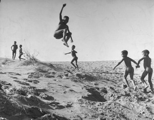 Bushman children playing games on sand dunes in the border area between Botswana and South Africa, 1947, Nat Farbman