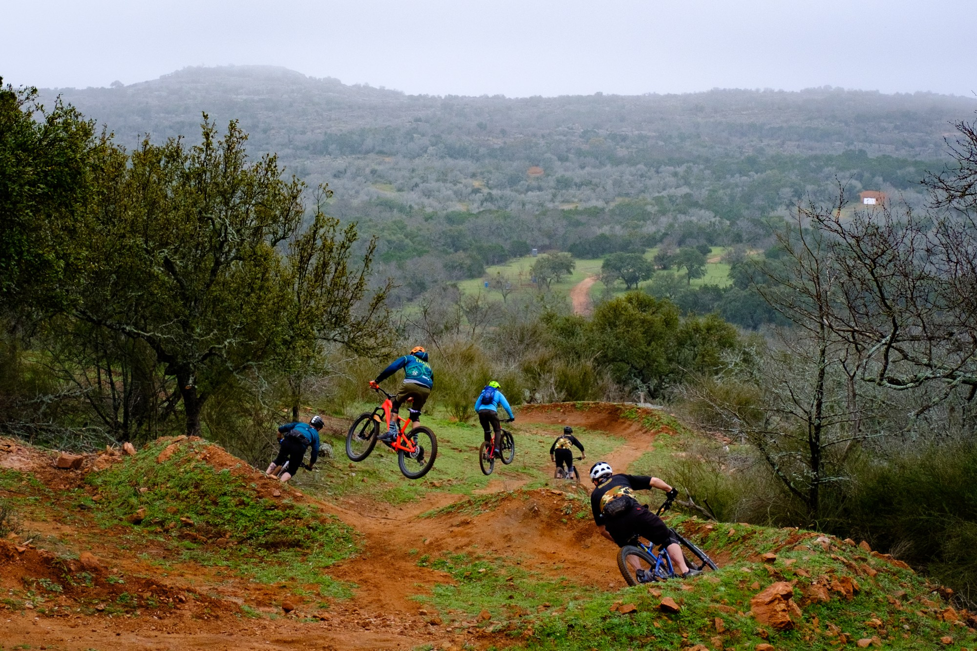 Mountain bikers on Cat Mountain in Austin, RX