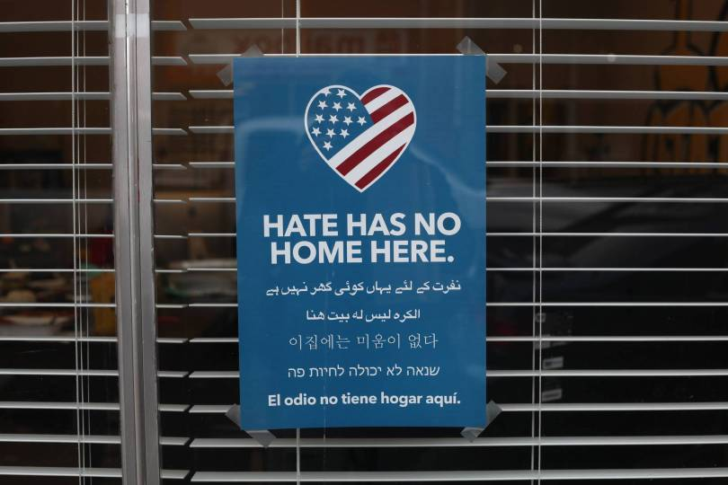 blue and white hate has no home here printed signage