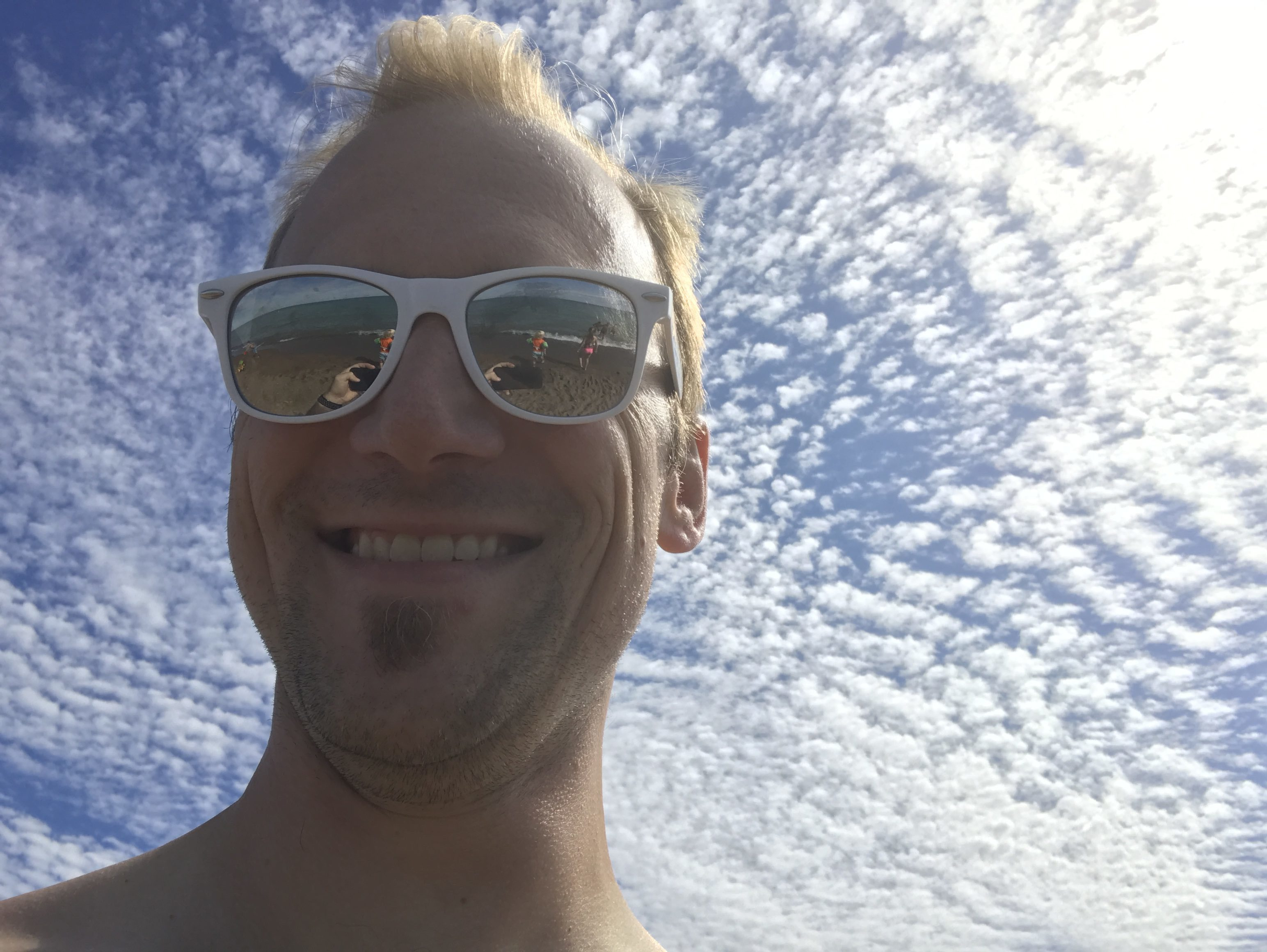 Jeff Paul selfie with blue sky and clouds in background