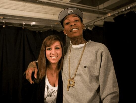 With Wiz Khalifa. He's the one in the hat.