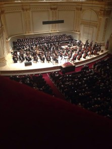 Chorus and orchestra on stage at Carnegie.