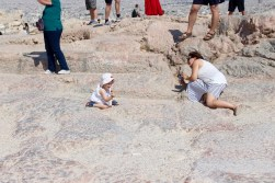 So adorable. In the background of this photo would be the east wall of the Acropolis.