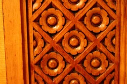 Carved wood panel.