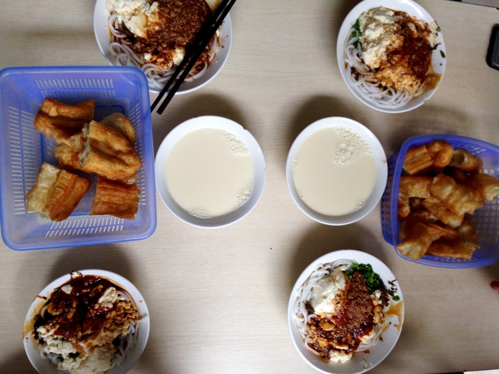 Yunnan breakfast. Step 1: fry dough. Step 2: dip fried dough in sweetened soy milk. Step 3: Eat it with morning bowl of spicy noodles.