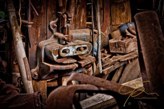 Part of the clutter of years found in an old abandoned barn