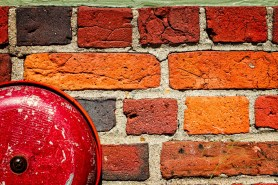 Fire Alarm Bell On Brick Wall