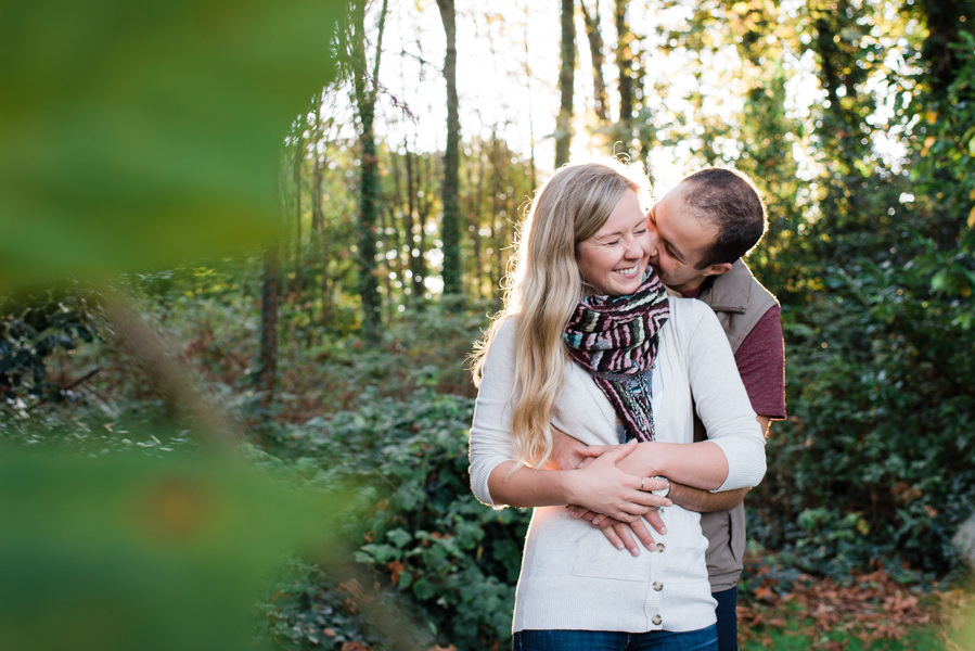 Couple having fun at Deep Cove engagement photo shoot in North Vancouver