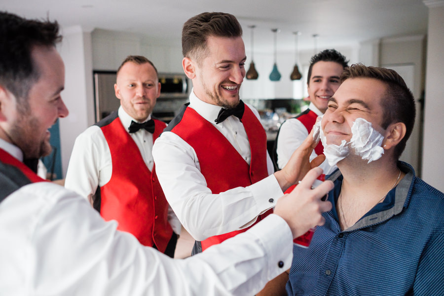 groomsmen having fun shaving groom in Burnaby