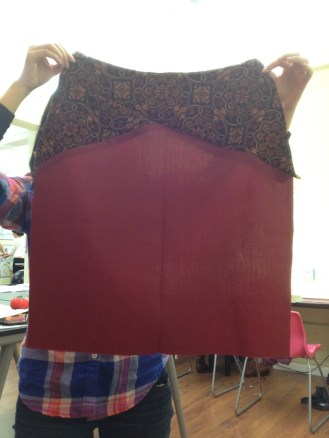 Me holding up the front of my skirt.