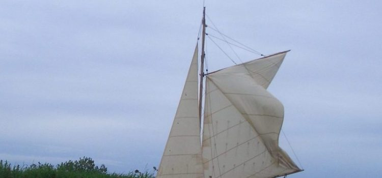 broads sailing boat at staithe