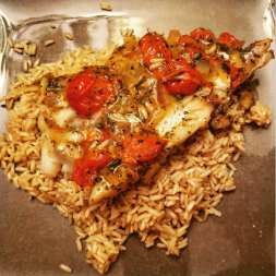 tomato basil cod with butter and herbs over brown rice