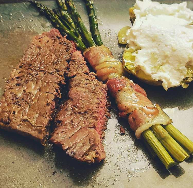 bacon wrapped asparagus served with steak dinner