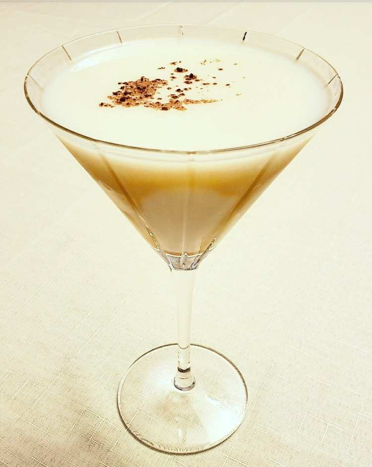 bananas foster martini made with vodka, butterscotch schnapps, chocolate liqueur, and banana liqueur