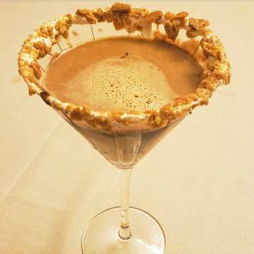 s'mores martini with vanilla vodka, chocolate liqueur, creme de cacao, marshmallow fluff, and graham crackers