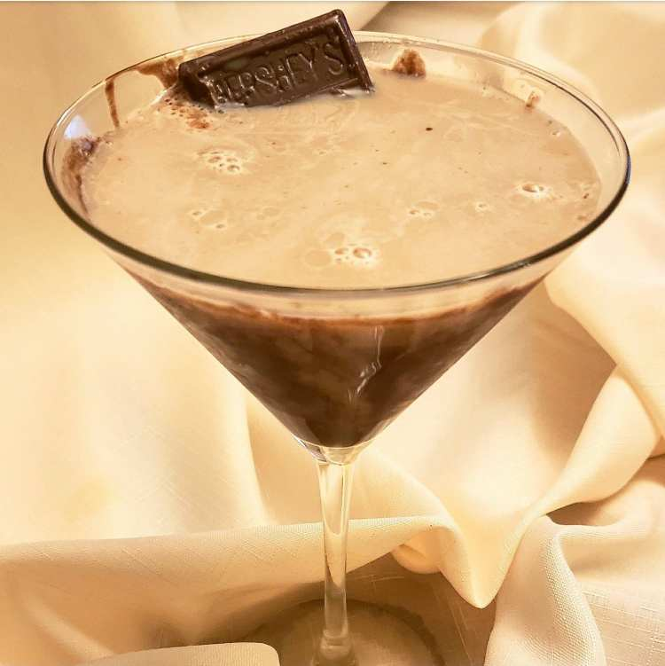 snicker licker martini with bailey's irish cream, frangelico, vodka, dark creme de cacao, and hazlenut liqueur
