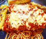 baked chicken parmesan with tomato sauce, panko bread crumbs, egg, parmesan cheese, italian seasonings, garlic powder, and pasta
