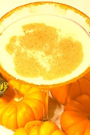 festive for fall and the best pumpkin pie martini recipe with pumpkin vodka, vanilla vodka, and baileys, irish cream
