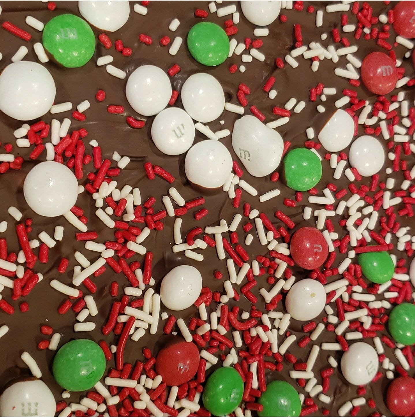 Christmas crack made with saltines, butter, brown sugar, melted chocolate and topped with mint flavored m & ms