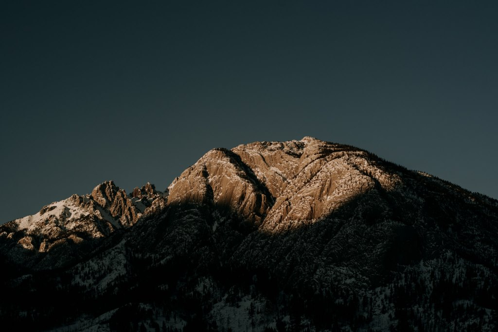 Photography of the sun setting on a mountain in Banff AB