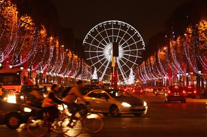 The Champs Elysees avenue in Paris is illuminated by Christmas lights.