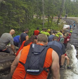 Dan, Mark, and Jen descending the ice-hill obstacle.