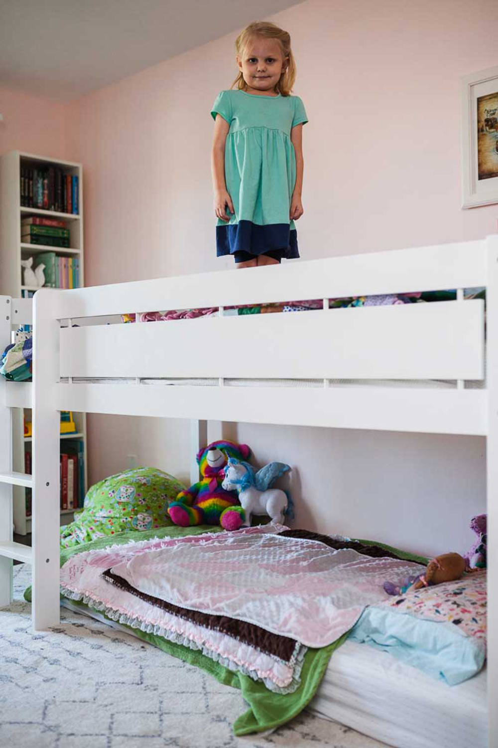 Before + after of our girls' shared bedroom, with their new wood floor and white loft bed.