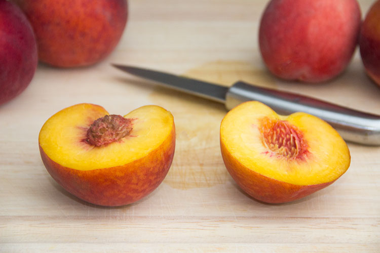 slicing-peach-in-half