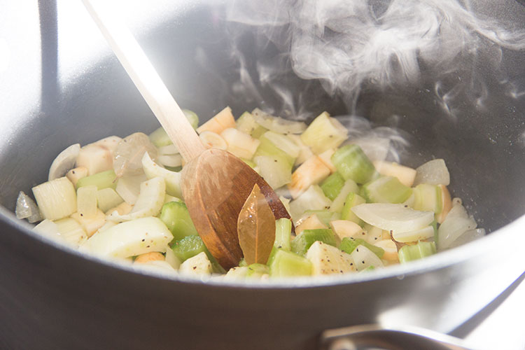 cooking-parsnips-onion-celery-in-soup