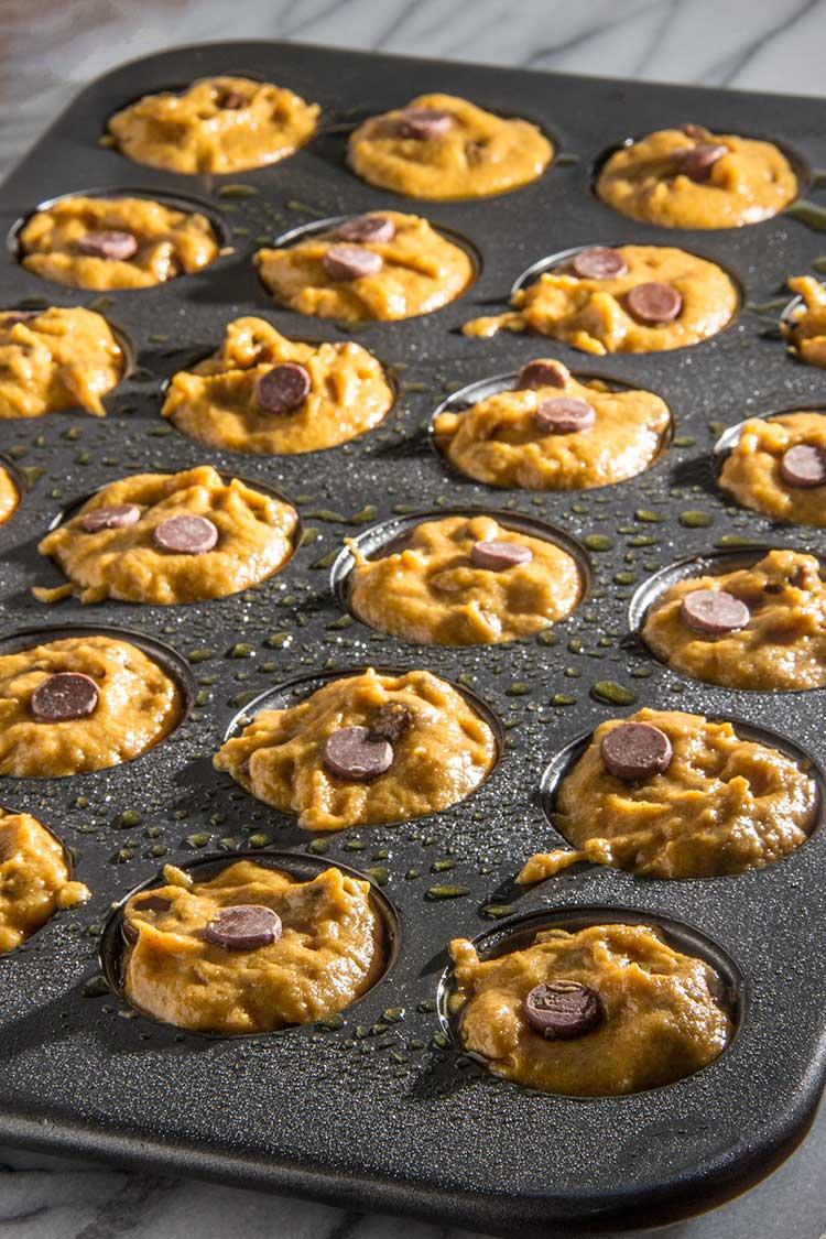 preparing-mini-chocolate-chip-pumpkin-muffins